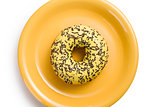 sweet doughnut on yellow plate