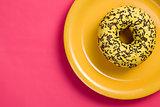 sweet doughnut on plate