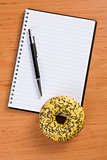 sweet doughnut and spiral notebook