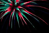 Abstract multicoloured firework burst using focus pull