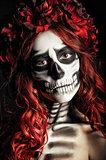 Closeup portrait of sad young girl with muertos makeup (sugar skull)