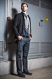 Fashion shot: portrait of handsome young man wearing jeans and coat