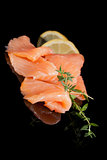 Culinary seafood. Salmon isolated on black.