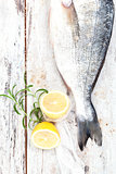 Seafood. Fish with lemon and herbs, top view.