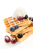 Waffle with berries and cream.