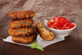 Falafel patty with tomatoes.