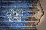Dark brick wall with plaster - United Nations
