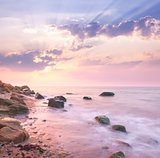 Dawn sunrise landscape over beautiful rocky coastline in the Sea