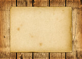 Blank vintage paper sheet on a wood board