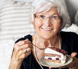 Senior woman enjoying cake