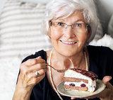 Senior woman enjoying cake