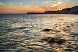 Landscape image of sunset over Birling Gap in England