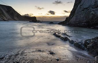 Beach sunrise landscape with long exposure waves movement