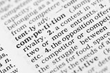 Macro image of dictionary definition of competition