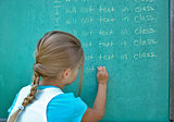 girl writing line on chalkboard