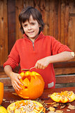 Boy carving his jack-o-lantern