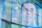 Face of male in window