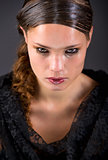 Beautiful brunette in tears isolated on black