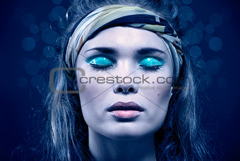 Beautiful young woman with blue make-up