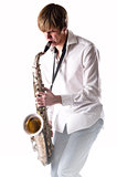 Young man with saxophone over white background