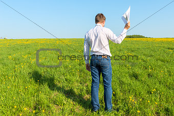 manager with papers out in the field