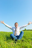 happy businessman enjoys the sun in nature
