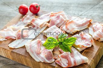 Bacon strips on wooden board