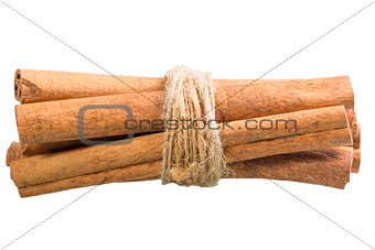 cinnamon sticks tied with a rope on a white background