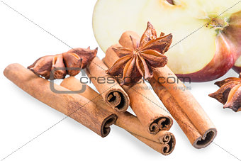fresh apple and aromatic spices on a white background
