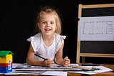 Girl-architect sitting behind Desk and looks in frame