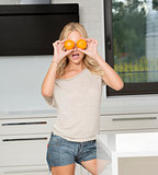 funny blond girl doing orange glasses