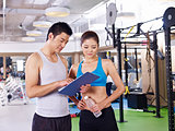 young man and woman discussing fitness plan