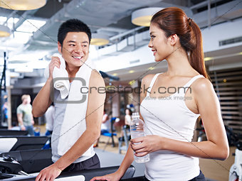 man and woman on treadmill