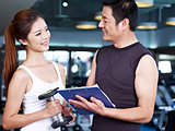 young couple working out in gym