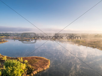 aerial view of a foggy lake
