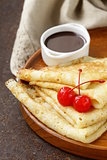 thin pancakes with chocolate sauce on a plate