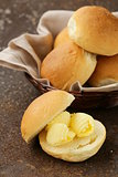 yellow dairy butter on a fresh bun for breakfast