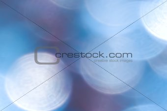 Abstract blue, white and violet circular bokeh background