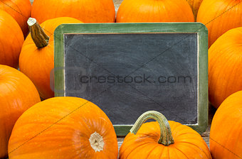 blank blackboard and pumpkin