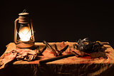 lamp, knife and a mask on the table