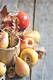 Pears and apples with fall leaves background