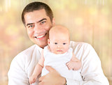 Portrait of father with baby at home
