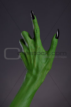 Green witch hand with black nails, real body-art