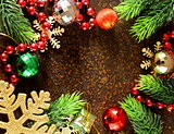 Christmas fir tree frame with decoration on the old iron background