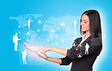 Women using digital tablet and silhouettes of business people