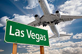 Las Vegas Green Road Sign and Airplane Above