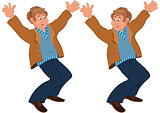 Happy cartoon man standing in brown jacket holding hands up