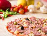 raw salami italian pizza with capers