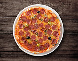 Italian salami pizza top view on wooden table