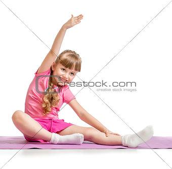 Little girl making sport exercises isolated  on white